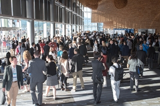 Delegates gather in the foyer at the International Congress in Vancouver, BC, Canada, June 2017.